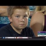 Kid at World Series of Baseball looks deep into audience's soul.