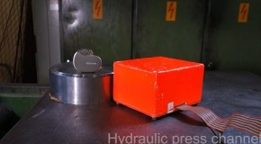 Crushing black box and pacemaker with hydraulic press