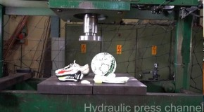 Crushing football stuff with hydraulic press