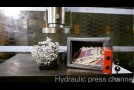 Crushing safe and sculpture with hydraulic press
