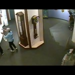 Man touches priceless museum clock