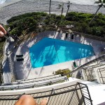 Crazy Dude Jumps From Roof Into Pool