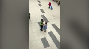 Heart-warming moment police officer dances with an elderly lady in a shopping centre