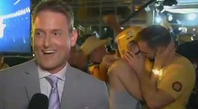Kissing Couple Caught on Camera Behind Reporter