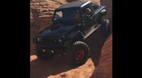 A Rear Steering Jeep Wrangler Driving Straight Down a Vertical Cliff Wall