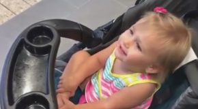 Little Girl Adorably Thinks Batman Statue Is Her Dad