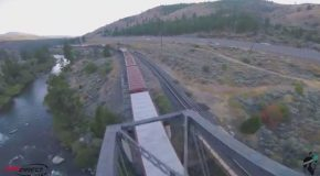 A Drone Performing Amazing Looping Tricks Above Trains