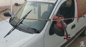 A Truck Plays the Violin With a Bow Attached Its Moving Windshield Wipers