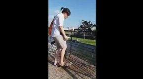 Oblivious Tourist Accidentally Destroys A Lamp Post