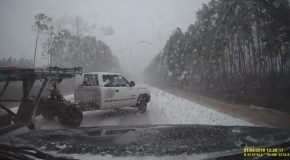 Pickup Truck With Trailer Jackknifes Off the Road During a Blizzard
