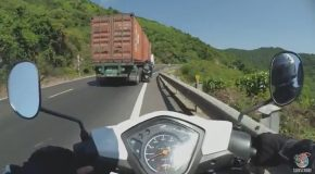 Truck Pushes Motorcycle Off Road, Clipping Rider