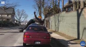 Man Performs Amazing Backflip Over a Parked Car