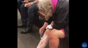 A Woman Shaves Her Legs in a New York Subway