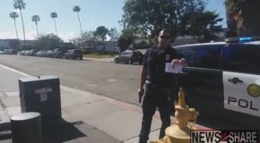 San Diego Officer Points Gun At Citizen For Having A Camera!