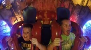 Two Boys on Slingshot Ride With Opposite Reactions