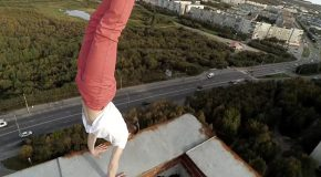 Guy Performs Impressive Handstand On Rooftop