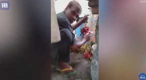 Shocking Moment Street Trader Spotted Spray Painting Grapes Red