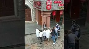 """Chinese Shop Owners Stop Machete Attack With Nifty """"Man Catchers"""""""