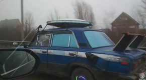 UFO Car Driving Down Highway