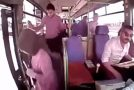 Oblivious Woman Steps Off Bus While It's Still Moving
