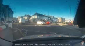 Car Collides with Cyclist in Roundabout